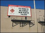 A new Toledo Firefighters Local 92 sign, seen by thousands of motorists a day, has appeared outside the union hall on Washington Street downtown.