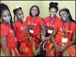 Robinson Elementary School's FeMale Robotics, with five of its six members, from left, twins Rytresha and Tylesha Smith, My'Yanna Bragg, Destinee Ferrell, and Caitlin Warts, was the only all-girl team at the tournament.