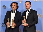 "Alejandro Gonzalez Inarritu, left, and Leonardo DiCaprio pose in the press room with the award for best motion picture - drama for ""The Revenant."