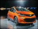 General Motors Co. shows off its Chevy Bolt EV, which can go from zero to 60 miles per hour in less than 7 seconds.