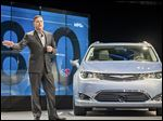 Chrysler brand chief Timothy Kuniskis introduces the 2017 Chrysler Pacifica Hybrid minivan at the auto show in Detroit.