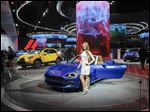 Fiat displays its 124 Spider at the 2016 North American International Auto Show in Detroit, where the automaker also outlined plans to make next-generation Wranglers in Toledo and to start making a Jeep pickup in Toledo in 2018.