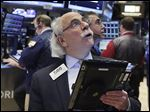 Trader Peter Tuchman works on the floor of the New York Stock Exchange. Stocks tumbled again Wednesday on fears of a global slowdown and plummeting oil prices.