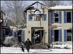 Investigators search a deadly house explosion, Tuesday, in Northfield Center Township, Ohio. The blast and subsequent fire happened Monday night.