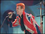 The late David Bowie performs during the VH1 Fashion and Music Awards in 1996 in New York.