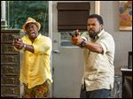 Kevin Hart, left, as Ben Barber and Ice Cube as James Payton in a scene from the film,