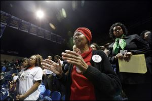 Shirley L. Smith of Toledo applauds the speech of the Rev. Cori Bush of Florissant, Mo., who gave the keynote address at the University of Toledo and the city's Martin Luther King, Jr., Unity Celebration at UT's Savage Arena.