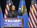 Former Republican vice presidential candidate Sarah Palin speaks to a crowd as she introduces Republican presidential candidate Donald Trump at a rally in Tulsa, Okla., Wednesday