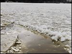 Ice forms on the Maumee River as temperatures turn colder. Experts warn that most ice is not safe yet for anglers.