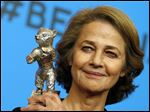 FILE - In this Saturday, Feb. 14, 2015 file photo, Charlotte Rampling holds the Silver Bear for Best Actress for her role in '45 years' after the award ceremony at the 2015 Berlinale Film Festival in Berlin, Germany. Academy Award-nominated actress Charlotte Rampling has entered the debate over a lack of diversity at the Oscars, saying the calls for a boycott are