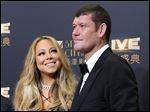 Singer Mariah Carey, left, and Australian businessman James Packer attend the opening ceremony for the Studio City project in Macau in October, 2015.