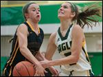 Oregon Clay's Hannah Hess (5) goes to the basket against  Whitmer's Julia Kimmel  (20).