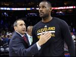 In this Nov. 2, 2015, file photo, Cleveland Cavaliers coach David Blatt pats LeBron James on the chest at the end of an NBA basketball game against the Philadelphia 76ers in Philadelphia.