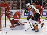Detroit's goalie Jimmy Howard deflects a shot by Anaheim defenseman Kevin Bieksa during the first period.