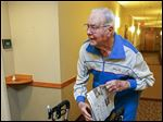 Harry Wagner, 97, gets up at 6 or 7 a.m. to deliver The Blade to customers on the first floor of Lutheran Homes' Wolf Creek, Creekside independent living facility, on Friday.