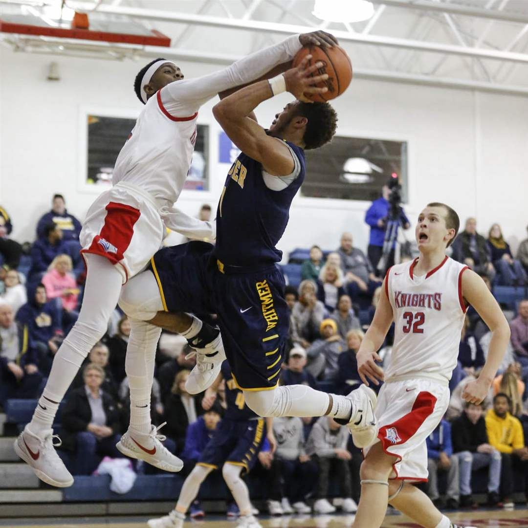 SPT-SFwhitmerBBK22pWhitmer-High-School-player-Mason-Durden-0-is-fouled-by-St-Francis-de-Sales-player-Ja