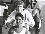 David Broadway evaluates the hair of Patty Fischhaber in 1985. A cut by Mr. Broadway was one of the priciest in town.