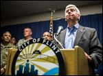 Gov. Rick Snyder speaks about the Flint, Mich., water crisis during a news conference at city hall in downtown Flint.