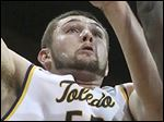UT's Nathan Boothe, who had 21 points and 12 rebounds, shoots over Ohio's Wadly Mompremier on Tuesday night.