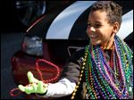 Bryan Walden, 9, catches more beads during the Ocean Springs Elks Lodge Mardi Gras parade in Ocean Springs, Miss. Saturday.