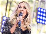 Carrie Underwood's 'Storyteller' tour kicks off today in Jacksonville. She will meet with selected military families in 10 cities. She said meeting with military families is a special experience.
