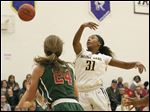 Notre Dame's Jala Johnson, right, breaks up a pass from Central Catholic's Katie Kovacs during the second quarter.