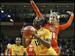 Toledo's Janice Monakana drives past BG's Miriam Justinger on Saturday. Monakana led four UT players in double figures with 21 points.