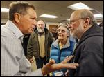 Gov. John Kasich campaigns in Rochester, N.H., in advance of the state's Feb. 9 presidential primary.