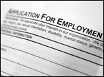 An employment application form on a table during a job fair. Jobless rates increased in Northwest Ohio during January.
