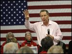 John Kasich speaks during a campaign event Thursday in Pelham, N.H. The Ohio governor's new ad touts his image as the mature Republican presidential candidate.