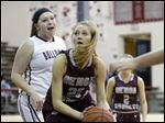 Genoa's Erica Harder drives past Rossford's Haley Gozdowski. Harder's fast start helped the Comets build an early lead. Harder had 25 points.