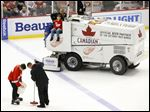 Crews repair the ice at Joe Louis Arena after an ice resurfacer cut into the ice between the second and third periods Saturday in Detroit.