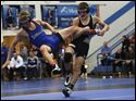 Perrysburg's Brock Jones earns two points for taking down Anthony Wayne's Ethan Baumbarger.