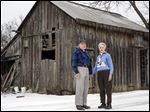 Douglas and Mary Ellen Pratt in front of one of the historic barns on their family homestead in Perrysburg Township.  Mr. Pratt's great-great grandfather, William, cleared the land from the Great Black Swamp after the War of 1812.