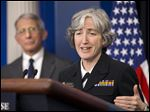 Dr. Anthony Fauci, director of NIH/NIAID, listens at left as Dr. Anne Schuchat, Principal Deputy Director of the CDC, speaks to the media during the daily briefing in the Brady Press Briefing Room.