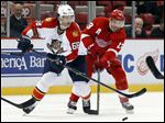 Florida Panthers right wing Jaromir Jagr (68) and Detroit Red Wings center Pavel Datsyuk (13) battle for the puck in the third period of Detroit's 3-0 win.