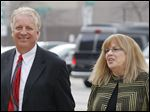 Toledo real estate investor James D. Moody and attorney Catherine Killam arrive for his arraignment, where he pleaded not guilty, at the U.S. District Court on Monday.