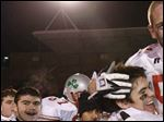 Robert Garber, an assistant at Central Catholic at the time, gives a player a hug following Central's win over Canfield in the 2005 Division II state championship game.