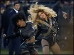 Beyonce performs during halftime of Super Bowl 50 on Sunday in Santa Clara, Calif. Red Lobster said in a statement that its sales surged after Beyonce mentioned the chain in a 'Formation' lyric. The seafood chain known for its cheddar biscuits says sales surged 33 percent on Sunday from a year ago.