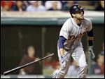 Detroit Tigers' J.D. Martinez watches his ball after hitting a three-run home run off Cleveland Indians in June, 2014.