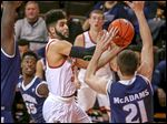 BGSU's David Joseph shoots in front of Akron's Reggie McAdams Tuesday at the Stroh Center.