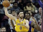 Cleveland Cavaliers' Kevin Love looks to pass around Los Angeles Lakers' Julius Randle in the first half before being injured.