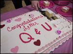 The cake is cut as kindergarten classes at Greenwood Elementary hold a wedding to celebrate Valentine's Day and the end of learning the alphabet.
