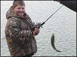 Trace Trumbull of North Baltimore enjoys a youth fishing event sponsored by the Henry-Wood Sportsman's Alliance.