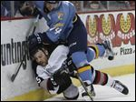 Toledo Walleye player Dominic Zombo flattens Brampton Beast player Steve Mele during the first period.