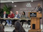 Monroe County Community College hosts a panel that included, from left, state Rep. Bill LaVoy (D., Monroe); David Thompson, Monroe County Drain Commissioner; state Sen. Dale Zorn (R., Ida); Robin Smith, adjunct instructor of sociology; and Joel Fiedler, adjunct instructor of sociology. MCCC president Kojo Quartey stands at the lectern.