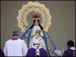 Pope Francis stands before Our Lady of Health,