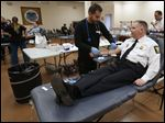 Red Cross' Ismail Abazied takes blood from Toledo Police Chief George Kral during the annual blood drive for fallen Detective Keith Dressel at the Toledo Police Patrolman's Association Hall in Toledo.