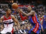 Detroit Pistons guard Kentavious Caldwell-Pope, center, loses control of the ball in front of Washington Wizards guard Ramon Sessions on Friday night in Washington.
