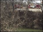 Toledo Fire and Rescue Department on the scene at Swan Creek near downtown Toledo where a body was found today.